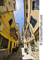 Narrow street in mediterranean town - Corfu, Greece