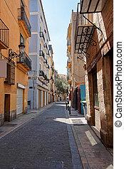 Narrow street in old city center of Valencia