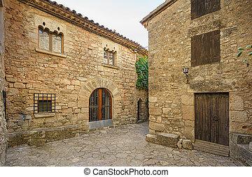 Narrow street in old medieval town of Siurana, Spain