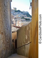 Narrow street in Ragusa Sicily - Ragusa Sicily built on a...