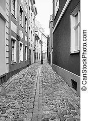 narrow street in Riga old town in autumn