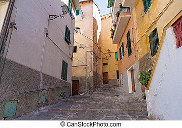 Narrow street in small Italian town on sunny day