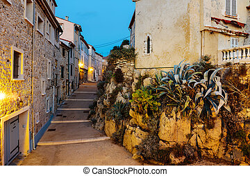 Narrow street in the old town Antibes in France. Night view
