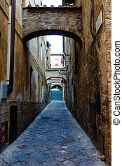 Narrow Street in the Town of Volterra in Tuscany, Italy