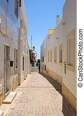 Narrow street in town of Albufeira in Portugal