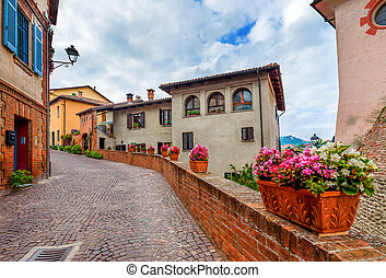 Narrow street in town of Barolo. - ow cobblestone street...