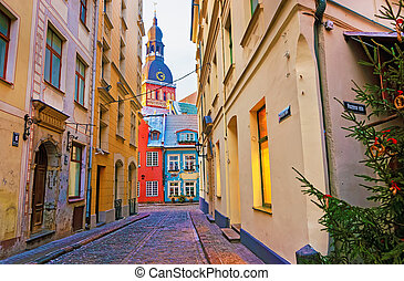 Narrow street leading to the St. Peter church in Old Riga