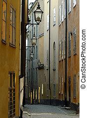 Narrow street - Narrow curving street with an array of ...