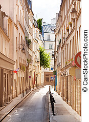 Narrow street Paris historical downtown district, France -...