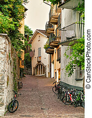 Narrow street with bicycles in Ascona of Ticino in ...