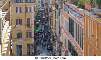 Narrow street with people in the center of Rome on a sunny day timelapse