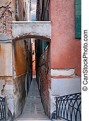 Narrow street wuth staircase in venice, Italy