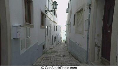 Narrow streets of Albufeira towards the sea. Portugal...