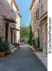 Narrow streets with flowers in the old village Gourdon, France