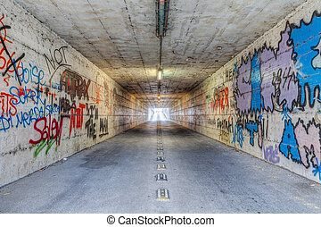 narrow tunnel with graffiti