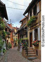 Narrow village street - Colorful narrow street with ...