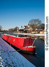 Narrowboat on river Cam - One red narrowboat on the river...