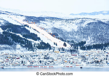 Narvik Cityscape with Skiing course dwon hill from mountain Lapland Norway