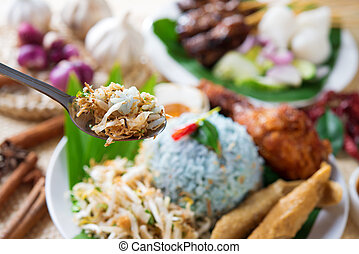 Nasi kerabu, famous Malaysian Malay rice dish. Traditional east coast blue rice. Popular in states such as Terengganu or Kelantan . Malaysia food, Asian cuisine.