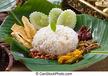nasi lemak, a traditional malay curry paste rice dish served...