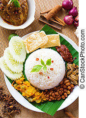 Nasi lemak kukus traditional malaysian spicy rice dish,...