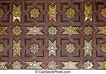 Intricate wood and gold leaf panelled ceiling in the Nasrid Palace, Alhambra, Granada, Spain.