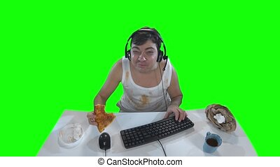 Nasty player on the computer with a piece of pizza