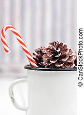 natal, cana doce, varas, em, lata branca, copo, com, abeto, cones., luz, colorido, photo., espaço, para, text.