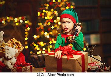 natal, concept., duende, criança, trabalhando, conversa telefone
