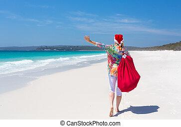 natal, em, austrália, -, festivo, mulher caminhando, ao longo, idyllic, praia, verão