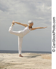 Natarajasana (King Dancer Pose) - Yoga balancing pose Aim...