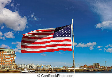 National American flag in front of the city of Boston