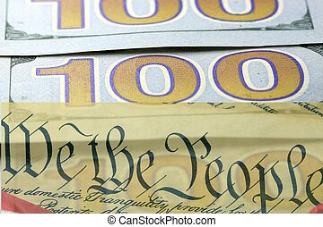 US Constitution with One Hundred Dollar Bills sitting above - The American Recovery and Reinvestment Act Government Concept