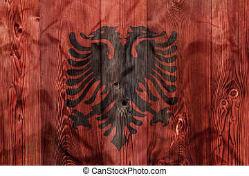 National flag of Albania, wooden background
