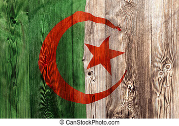 National flag of Algeria, wooden background