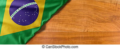 National flag of Brazil on a wooden background with copy space