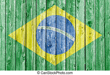 National flag of Brazil on old white wood background