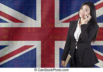 National flag of britith with a large display of daily stock market price