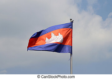 National flag of Cambodia on bright blue sky background. Blown away by wind.