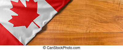 National flag of Canada on a wooden background with copy space