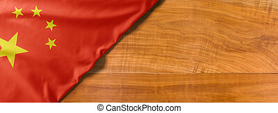 National flag of China on a wooden background with copy space