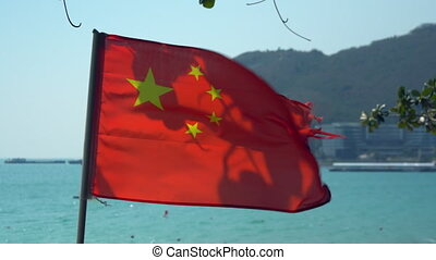National flag of China with sea view in the background