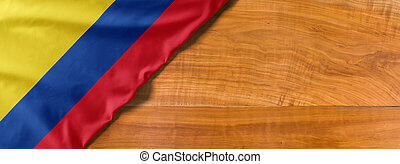 National flag of Colombia on a wooden background with copy space