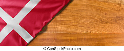 National flag of Denmark on a wooden background with copy space