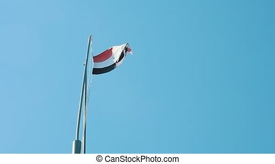 National flag of Egypt fluttering on a flagpole on a sunny...