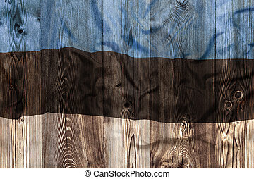 National flag of Estonia, wooden background