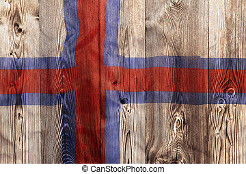 National flag of Faroe Islands, wooden background