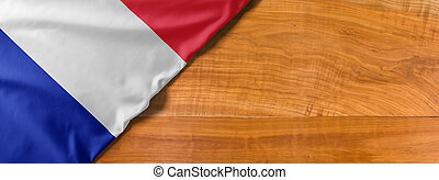 National flag of France on a wooden background with copy space