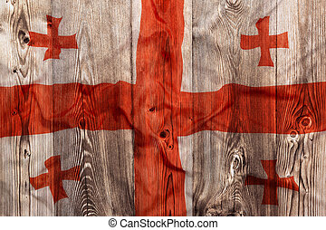 National flag of Georgia, wooden background