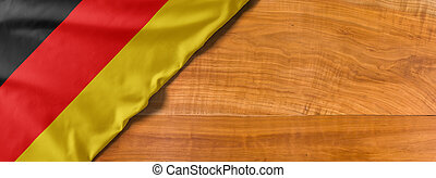 National flag of Germany on a wooden background with copy space